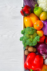 Assortment of fresh vegetables on wooden table
