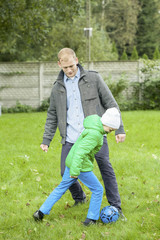 Playing football together with son