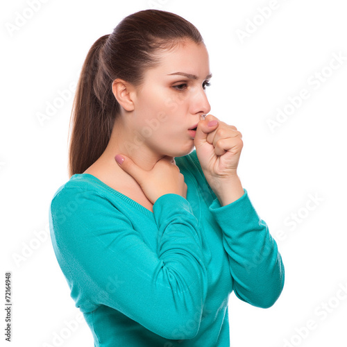 portrait of an young woman coughing with fist - 72164948
