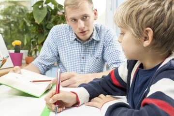 Little student doing homework