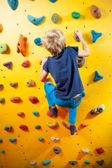 Little boy on the climbing wall