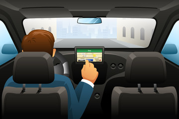Driving man using GPS to find a location