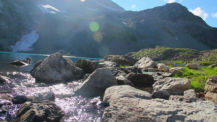 Clear mountain stream flows, beautiful lake scenery steadicam