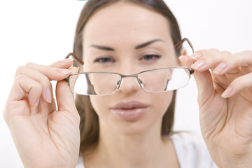 Optics and Glasses, Portrait of young woman looking through her
