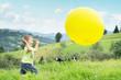 Laughing boy chasing a balloon