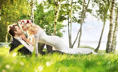 Just married couple relaxing on the meadow