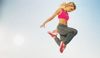 Portrait of jumping fit woman