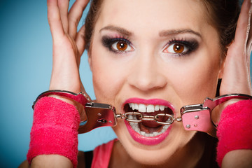 teen crime - teenager girl in handcuffs