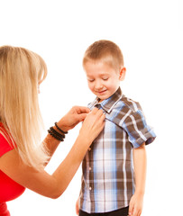 Mother and son buttoning on shirt isolated
