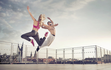 Athletic couple during the jump training