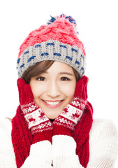 young smiling woman in winter clothes and touching face - isolat