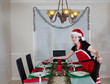 Young Girl preparing Dining Table for Christmas Dinner