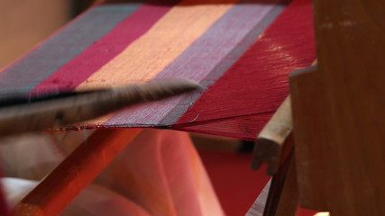 Weaver working on the loom