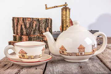 Tea set with teapot on wooden table