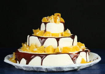 Beautiful wedding cake with oranges and chocolate