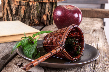 vintage strainer on a plate on wooden table with  old book,