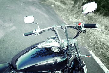 Motorcycle detail with gasoline tank and speedometer. Chrome