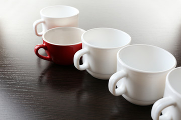 Individuality concept. Group of cups close up