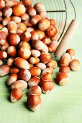 Hazelnuts in basket on wooden background