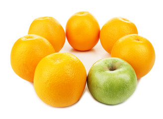 Juicy oranges and apple, isolated on white