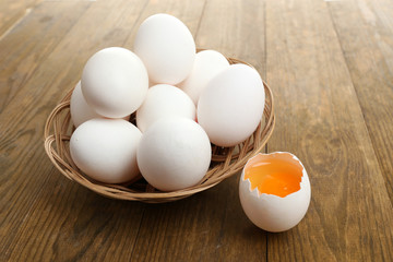 Eggs on wooden table close-up