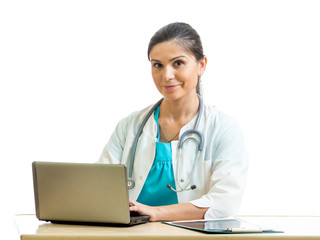 smiling physician working at laptop isolated