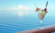 A tropical drink on a cruise ship rail with ocean in the backgro - 72175920