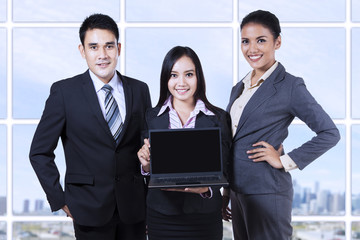 Business team with laptop on business presentation