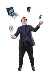 Businessperson juggling in studio