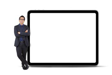 Businessperson leans on billboard