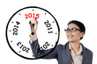 Businesswoman drawing annual clock