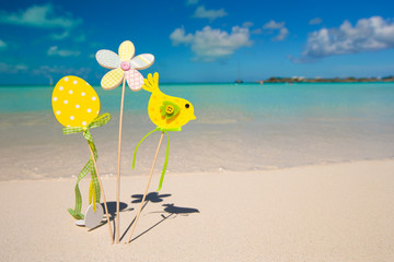 Easter decorations on a background of tropical beach