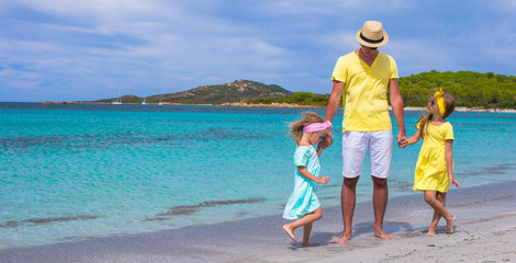 Father and little girls have fun during tropical vacation