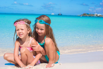 Adorable little girls in swimsuit and glasses for swimming at
