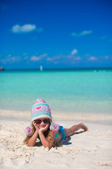 Portrait of adorable little girl on summer vacation at white