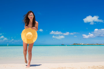 Young woman with hat on the beach enjoy caribbean vacation