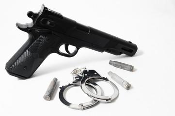 Pistol Gun and Handcuffs