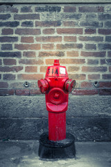 Old red hydrant in the dark lane