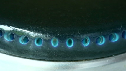 gas ignited by lighter, burns and goes out in the burner gas sto