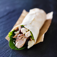chicken spinach mushroom wrap on slate