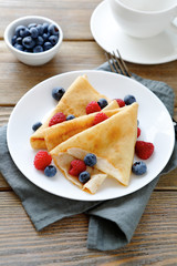 delicious pancakes, crepes with raspberries and blueberries