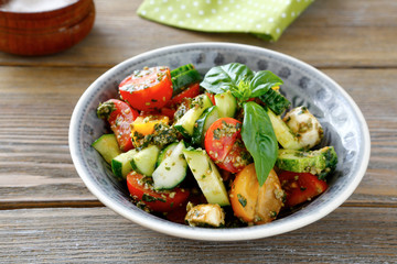 salad with vegetables and pesto in bowl