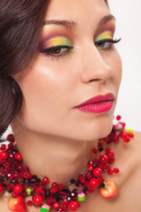 Beautiful young woman with evening make-up in the style of the s