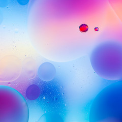 macro of colorful oil drops on water