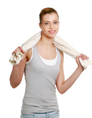 Young woman with a towel, isolated on white background