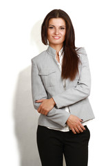 Portrait of beautiful business woman standing with folded arms,