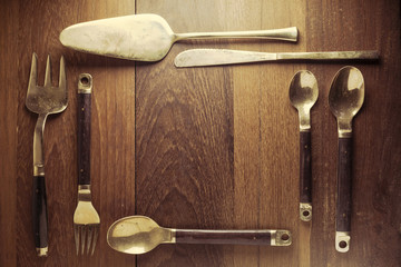 spoon fork and knife on wood background