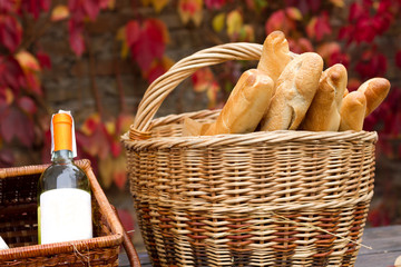 Baskets with wine and bread