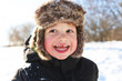 portrait of smiling toddler walking in winter outdoors