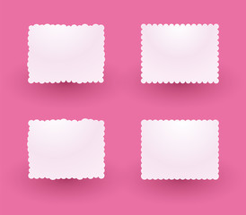 white decorative labels on a pink background